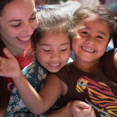 A volunteer on an alternative spring break in Costa Rica plays a game with a child.